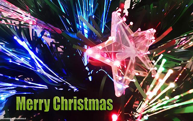Kerst wallpaper met kerstverlichting, ster en de tekst Merry Christmas