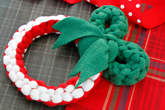 DIY homemade Christmas wreath dog tug toy (red and white, with green bow)