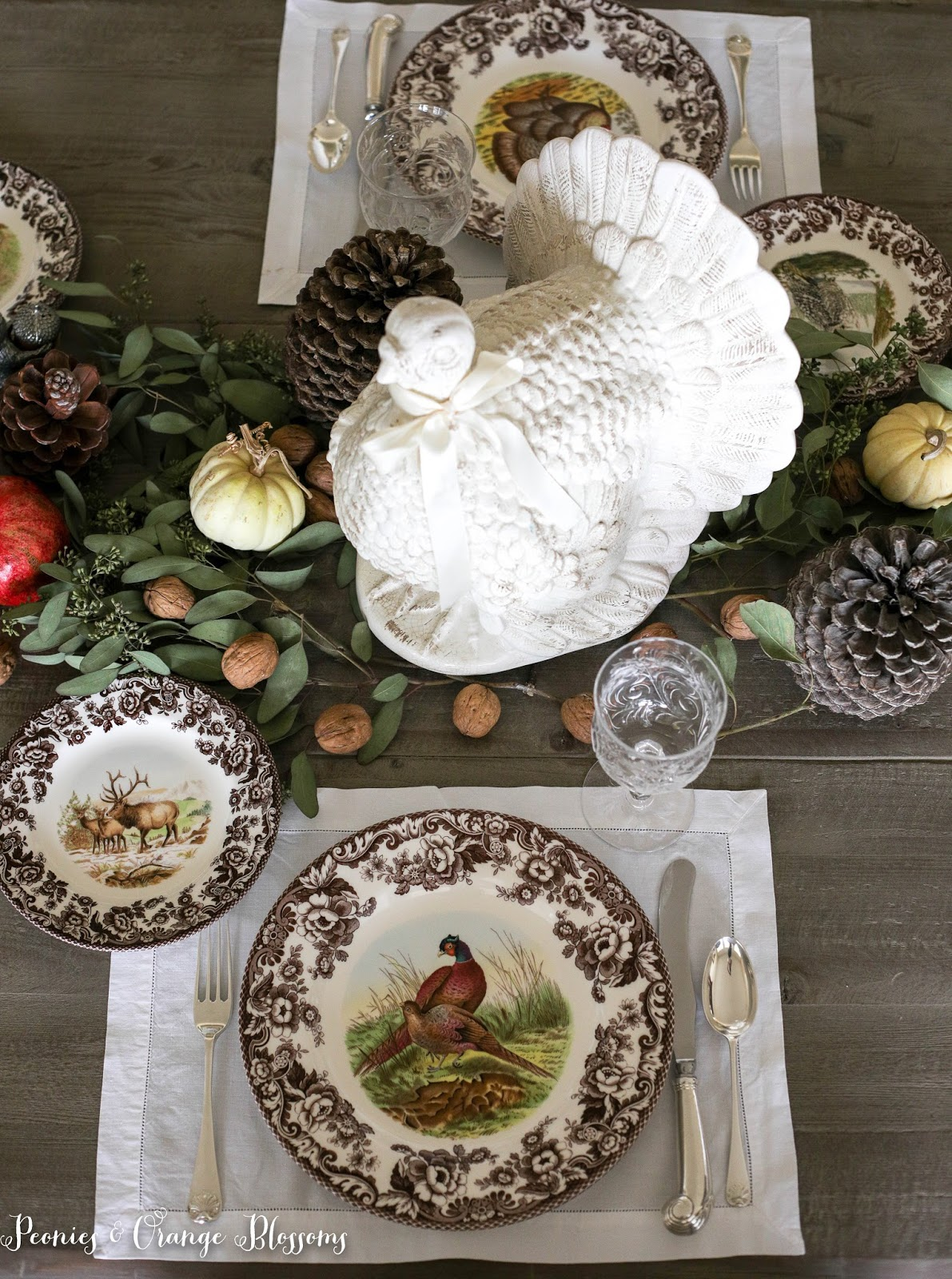 Natural Farmhouse Thanksgiving Table with spode Woodland plates, pomegranates, walnuts, pumpkins and pinecones