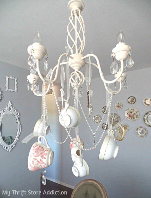 DIY Whimsical Teacup Chandelier mythriftstoreaddiction.blogspot.com Create a one of a kind chandelier with thrift store teacups, faux pearls and vintage spoons!