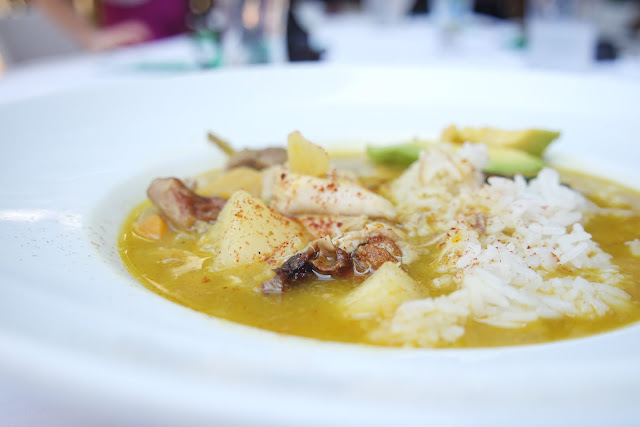 Chef Martín Omar's Sancocho served over rice with freshly sliced avocado.