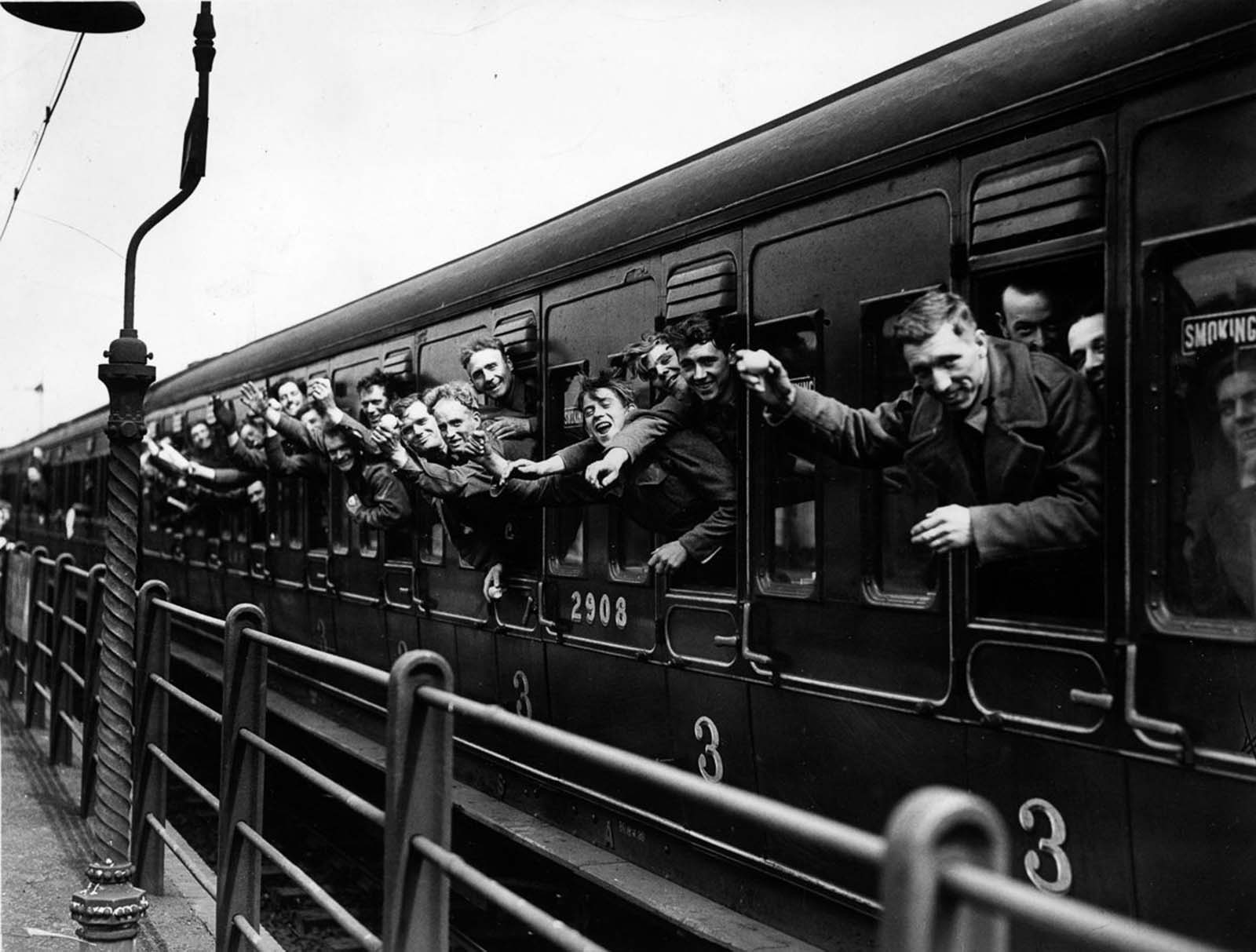 A trainload of British Expeditionary Force soldiers arrives back in London.