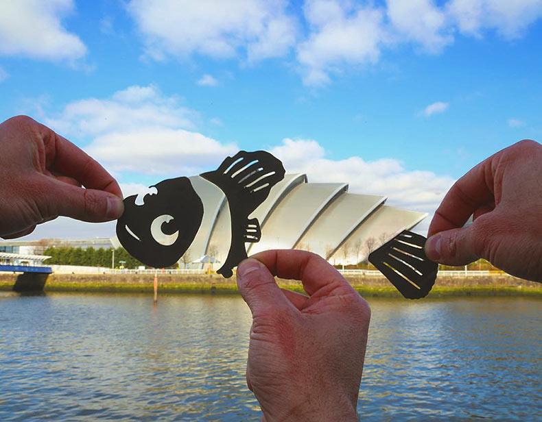Artista transforma famosos lugares, con peculiar recortes de papel salidos del Cine