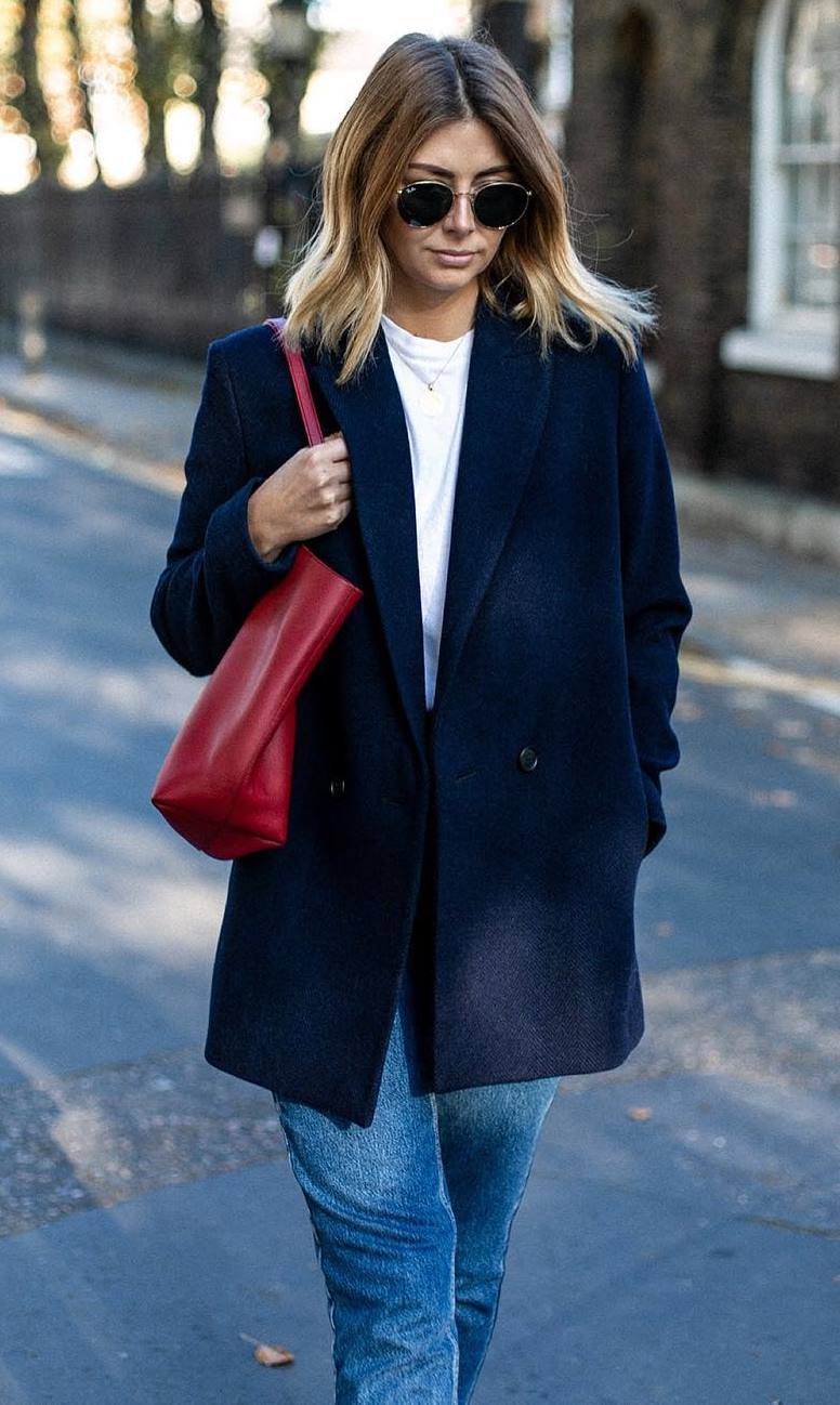 casual outfit inspiration / blazer + white top + red bag + jeans