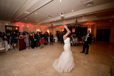 The Bride throwing her flower bouquet