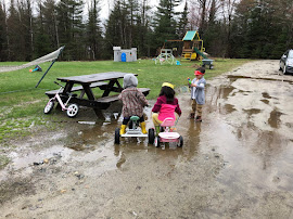 Indy Thomas, Hazel Nina, Campbell Walker playing in the April mud