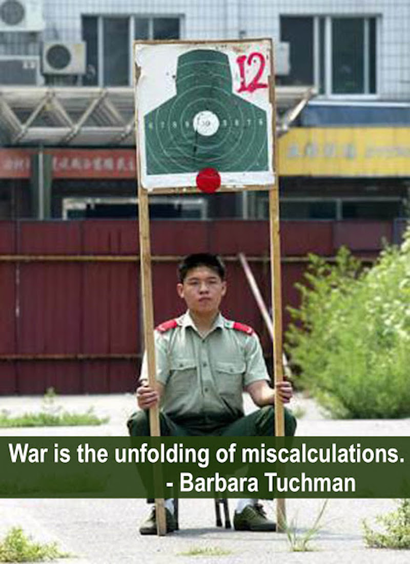 Chinese man in uniform holding up a target. War is the unfolding of miscalculations. Tuchman Competition of Incompetence and Other stories of Military Intelligence marchmatron.com