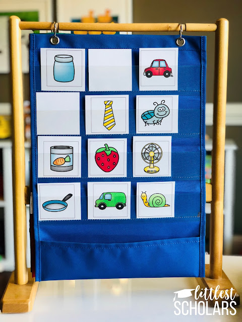 This simple game helps children recognize rhyming words! Each row on the pocket chart has 3 pictures--2 that rhyme and 1 that does not. Say the picture words and flip the card over that doesn't rhyme!
