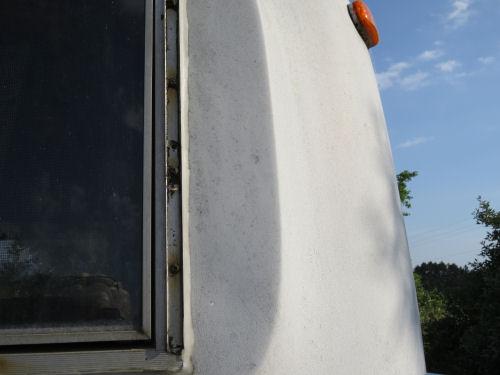 dirty fiberglass trailer exterior