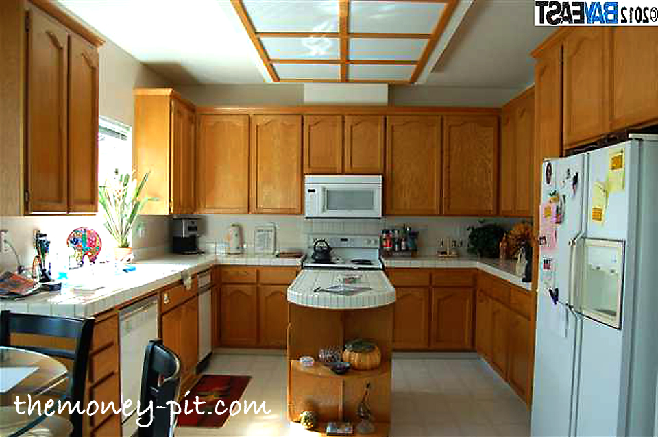 updating 1980s kitchen cabinets awesome fluorescent light white tile countertops and 27727