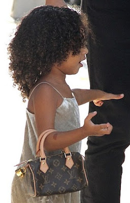 cfb97d285407 North West stepped out in a nice velvet dress and her mini bowler-style Louis  Vuitton bag slung casually on her arm on Thursday in New York.