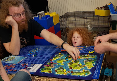 Family playing Blue Lagoon board game together