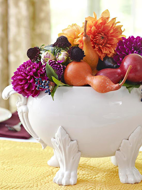 This centerpiece of fresh flowers and fall fruits is adorable for the changing season.
