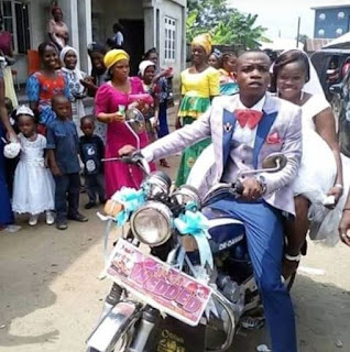 PHOTO: Bride rides with her groom on a customized motorcycle on their Wedding Day.