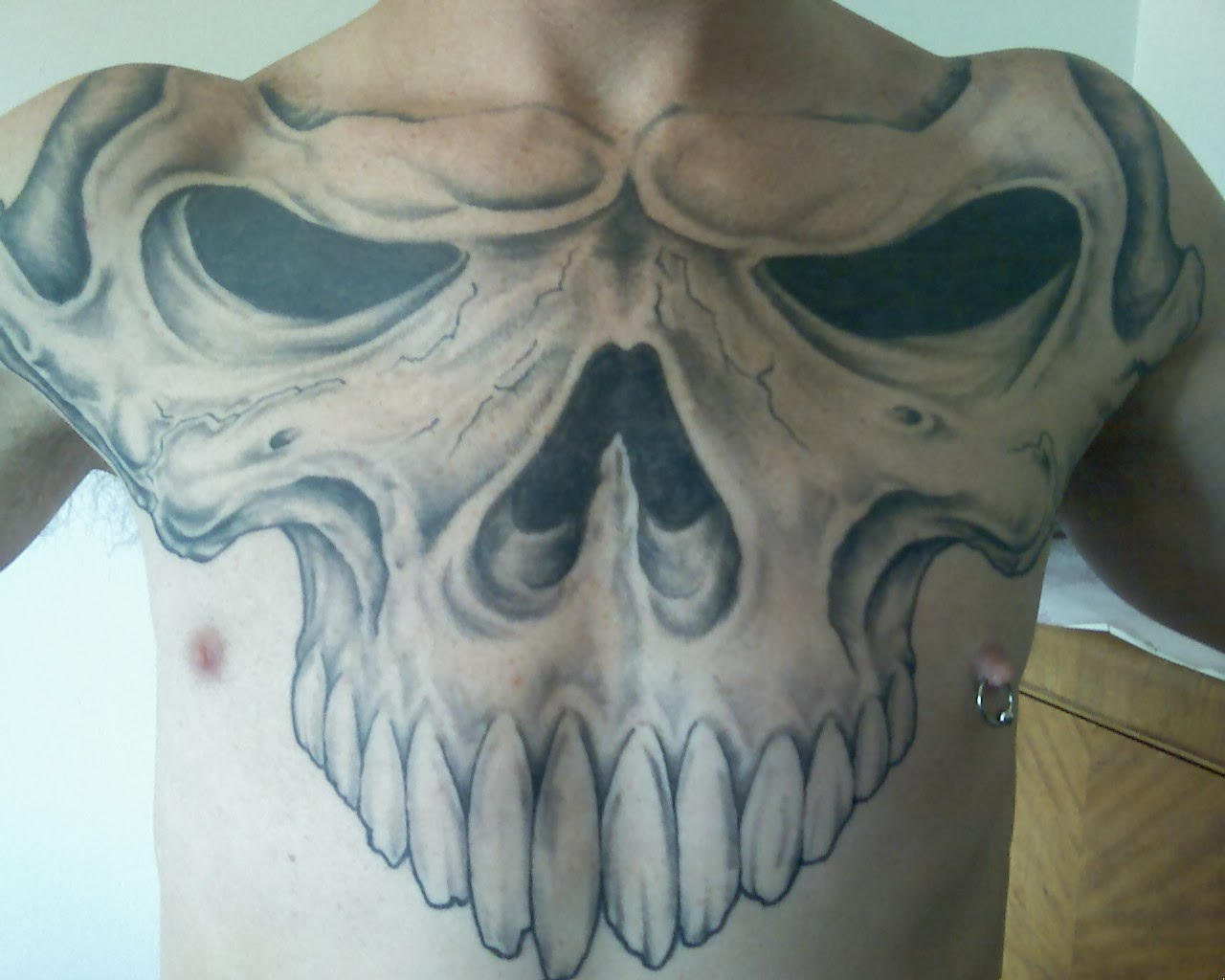 Skull And Chest Tattoo