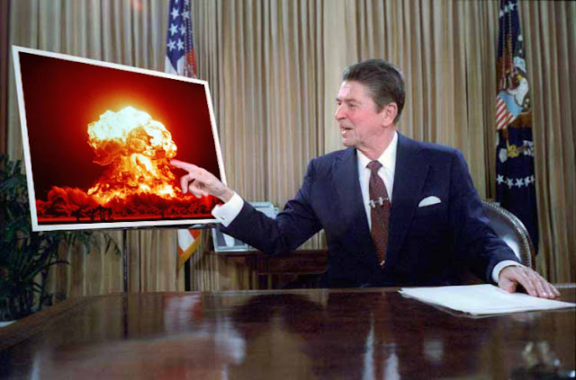 Reagan pointing at a nuclear explosion