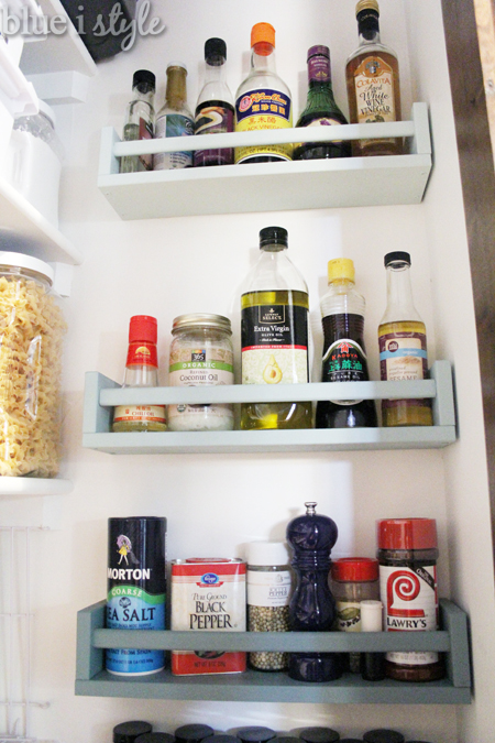 Spice and oil storage on pantry wall