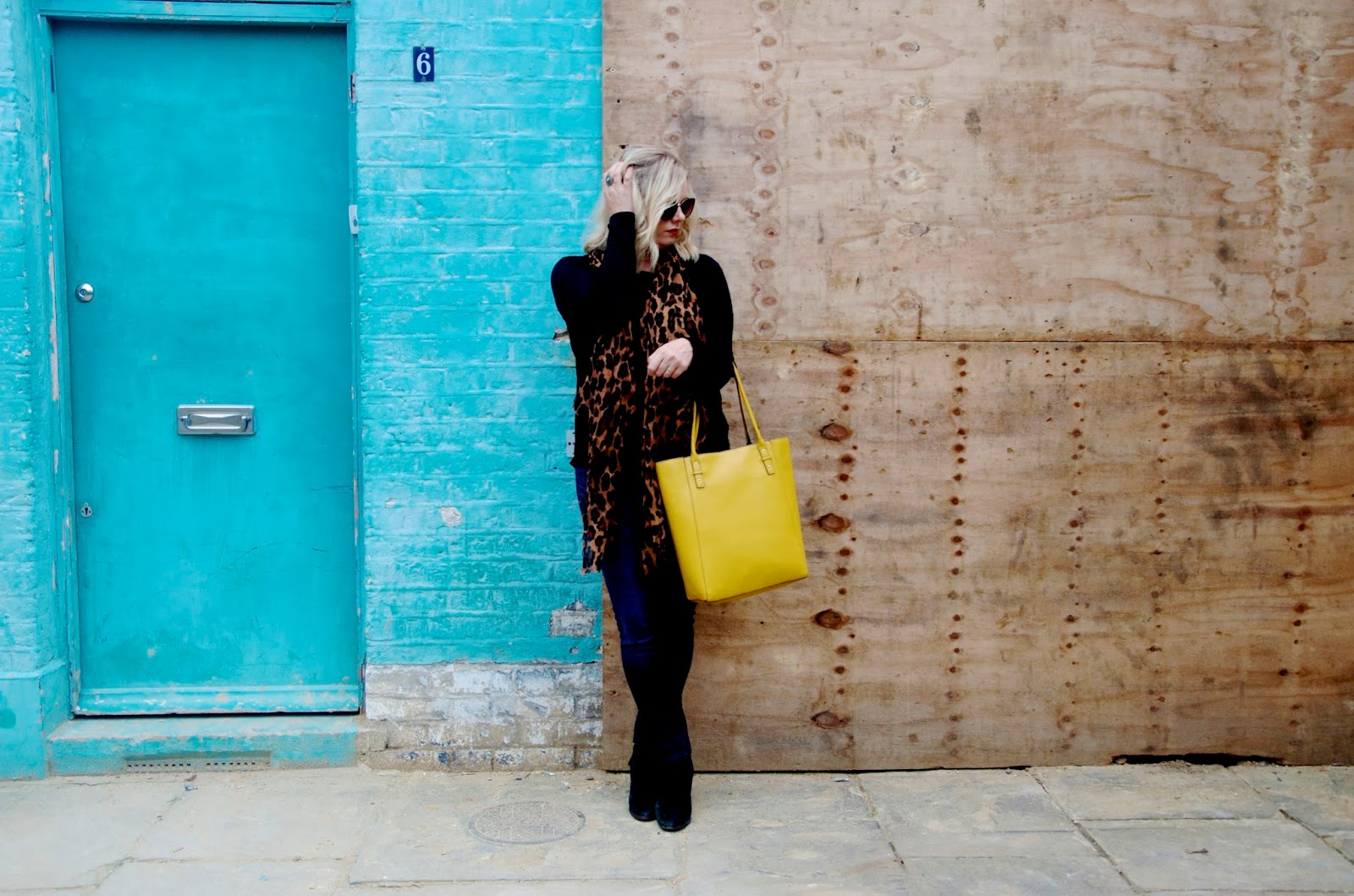 Blue Wall, leopard print and yellow bag