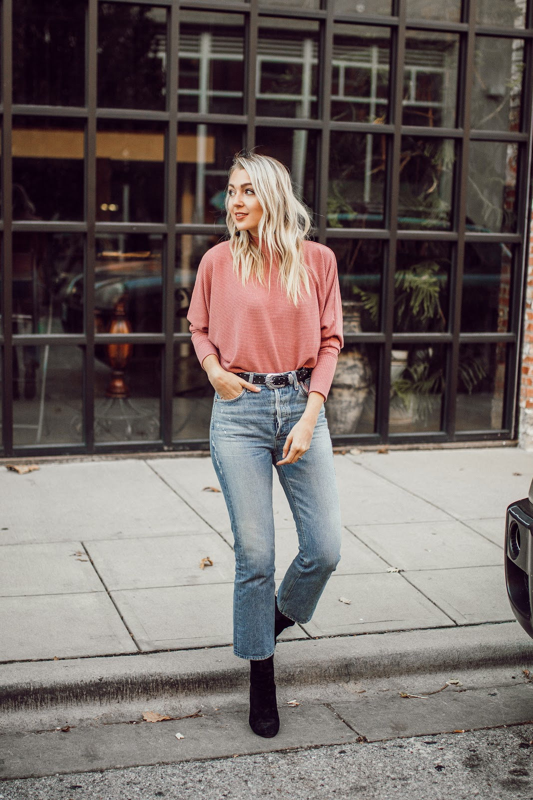 pink sweater, cropped jeans