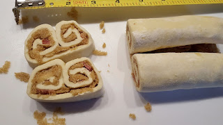 pastry slices filled with brown sugar and bacon, unbaked, measuring tape