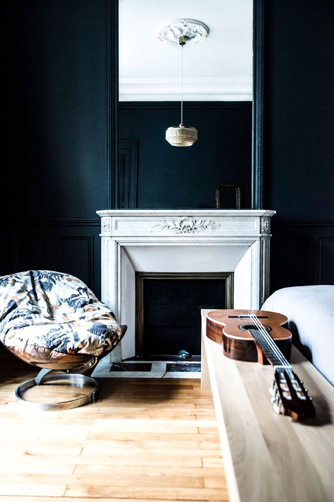 dark green wood paneling and white fireplace