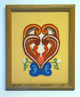interlaced hearts in crewel embroidery