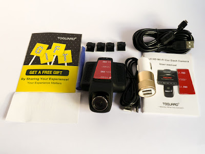 box contents - camera, long USB cord, cable clips, cigarette lighter socket USB charger, spare 3M sticky tape