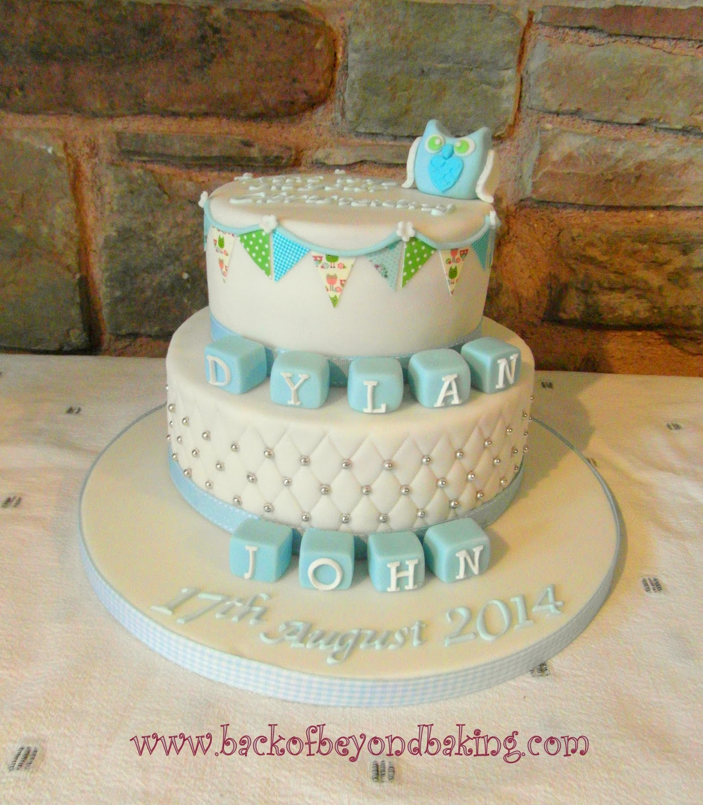 owl, bunting and letter block christening cake