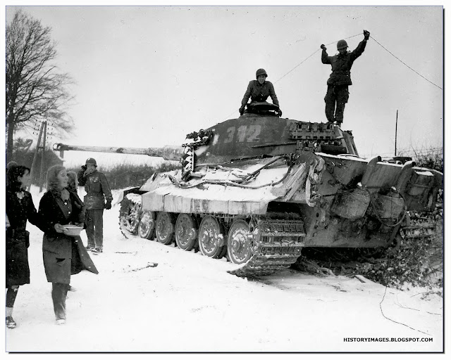 American soldiers inspect  German Tiger tank  Belgian village  Corenne February 1945