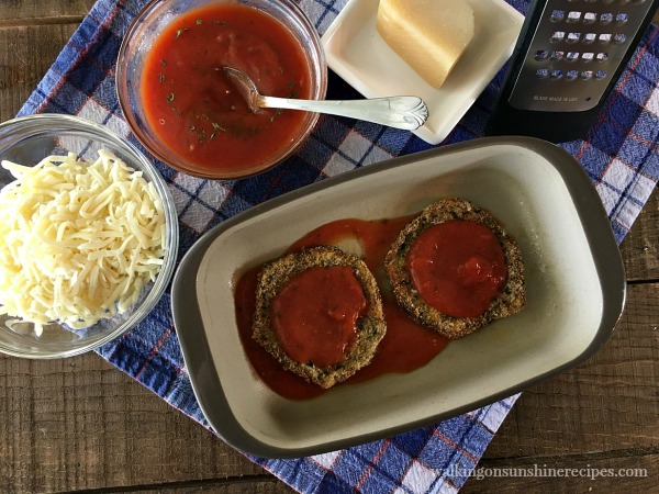 Add homemade sauce to the eggplant layers for Healthy Baked Eggplant Parmesan from Walking on Sunshine