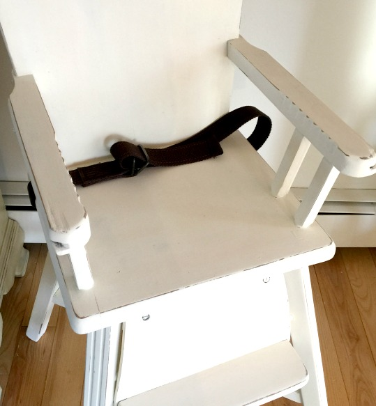white high chair with seat belt