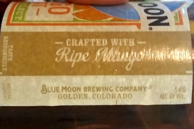 close-up on the right side of the label for Blue Moon Mango Wheat: crafted with ripe mango