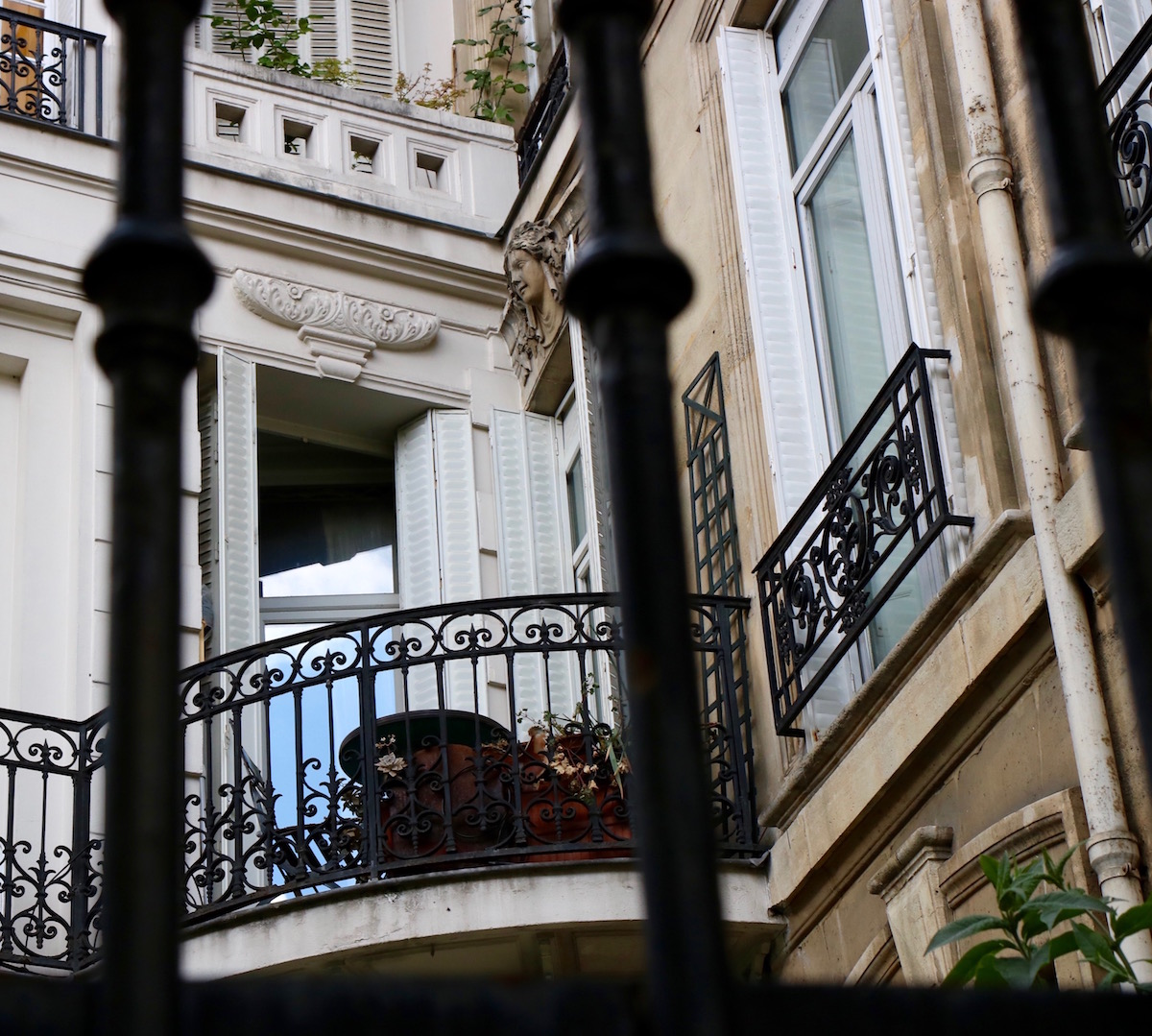 Gorgeous French iron balconies on private Avenue Frochot in Paris