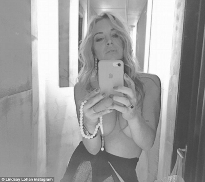Lindsay Lohan celebrates the opening of a Club that was named after her by her new boyfriend with a half nude selfie