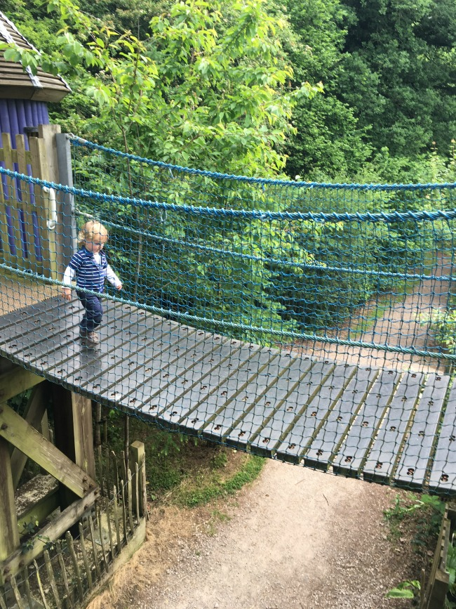 toddler-running-back-cross-bridge-with-view-of-ground-at--Perrygrove-Railway-adventure-playground