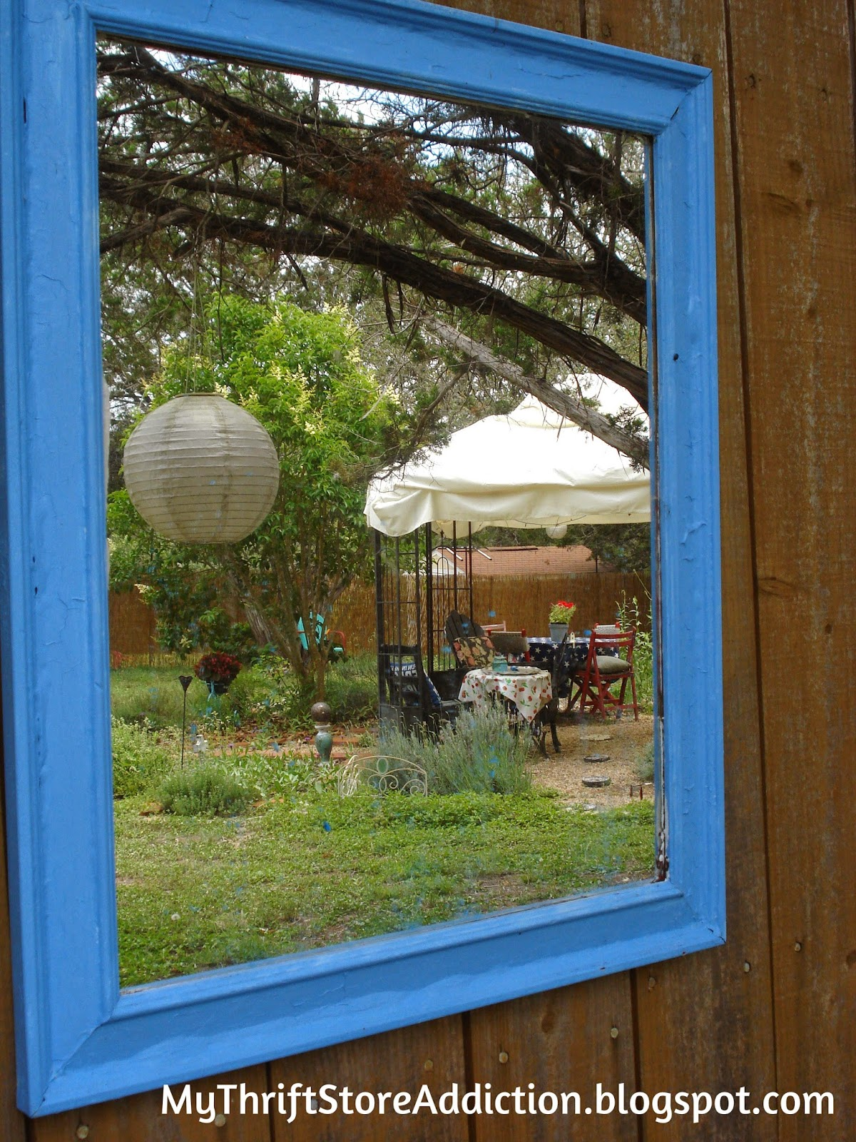 Welcome to Secret Garden: My Creative Space! mythriftstoreaddiction.blogspot.com A blue framed mirror reflects a view of the gazebo