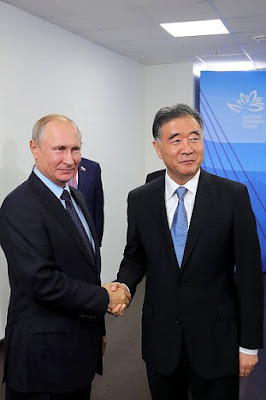 Vladimir Putin with Vice Premier of the Chinese State Council Wang Yang.