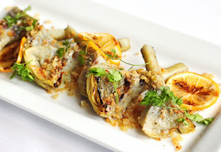 http://paragarys.com/the-epicurator/recipes/grilled-artichokes-with-garlic-anchovy-lemon-and-breadcrumbs/