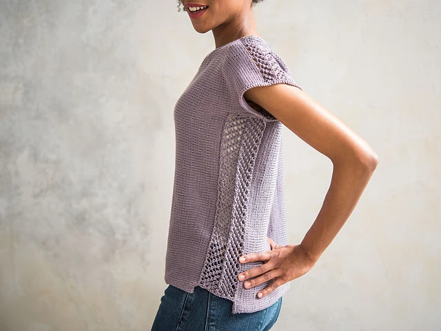 Easy to knit simple summer top with lace panels on the shoulders and sides.