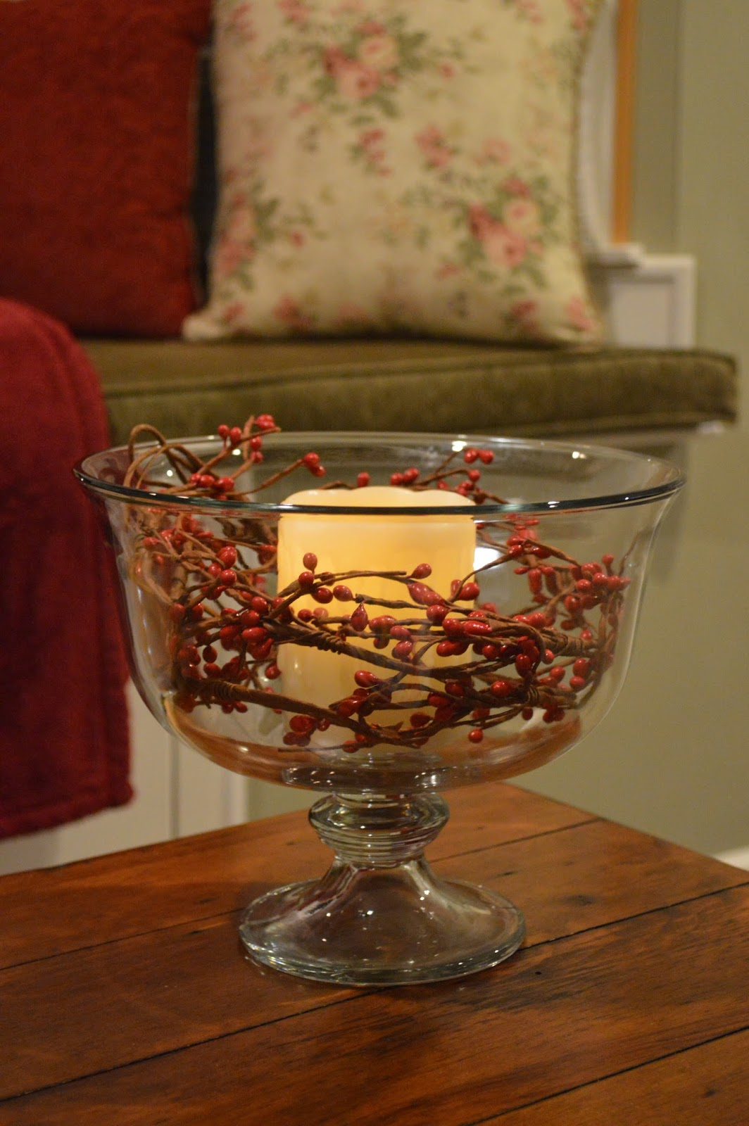 Glass bowl with candle and berries inside