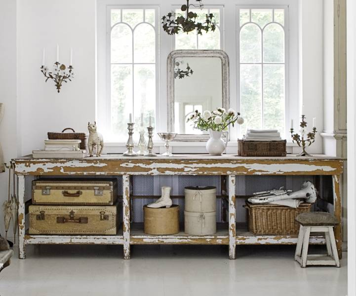 These vintage suitcases pair well with the distressed wood furniture.