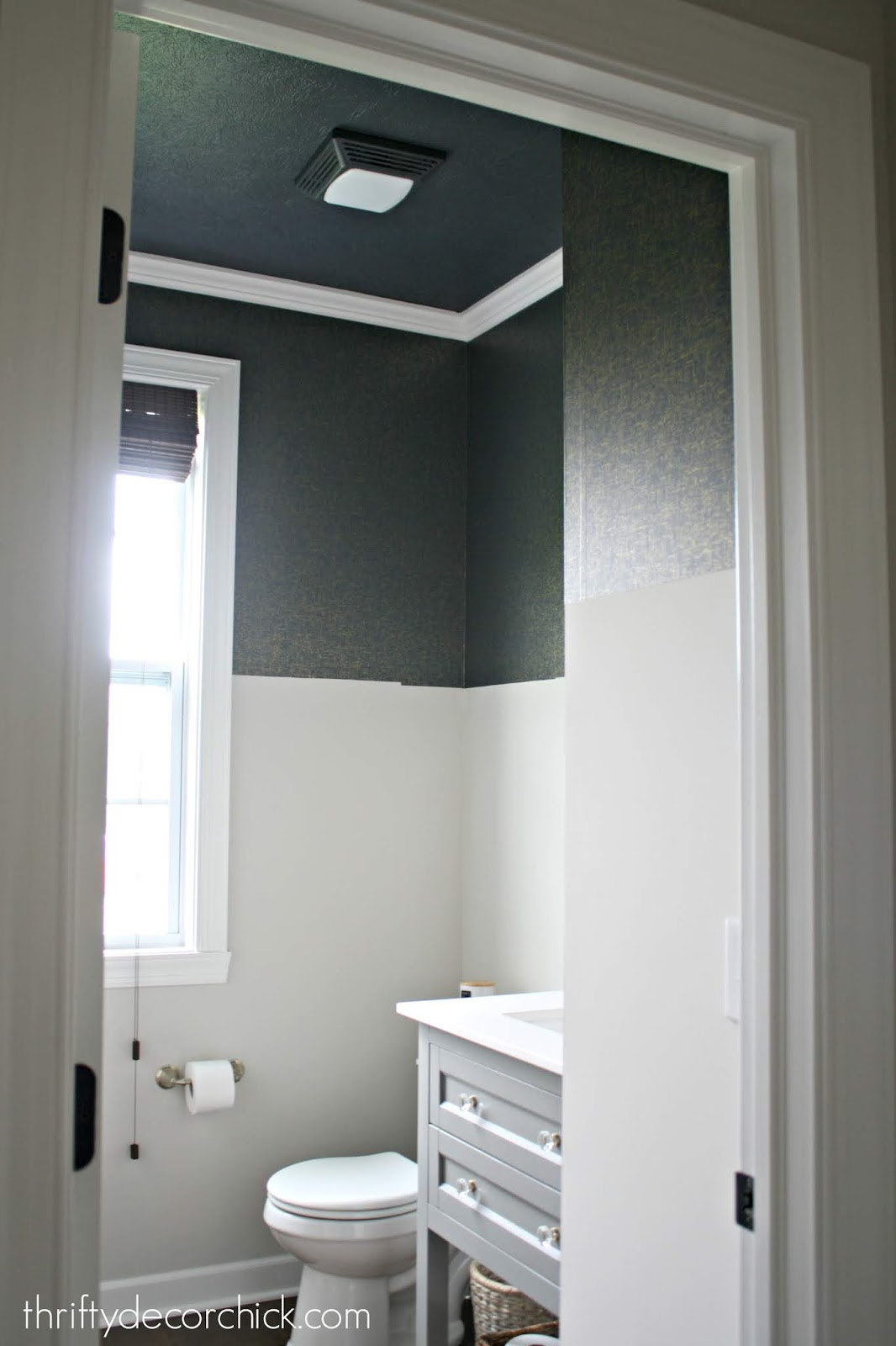 Dark painted ceiling in bathroom