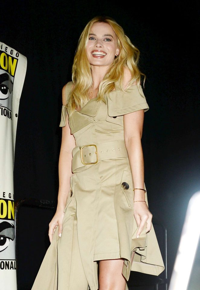 Margot Robbie wears a raincoat inspired dress to Comic-Con 2016