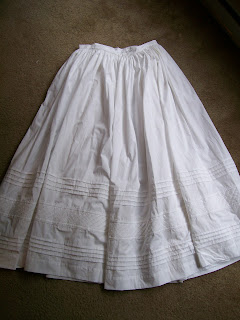 White cotton petticoat with diagonal tucks.