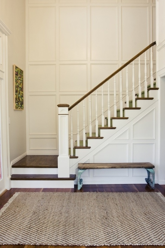 staircase with paneled walls