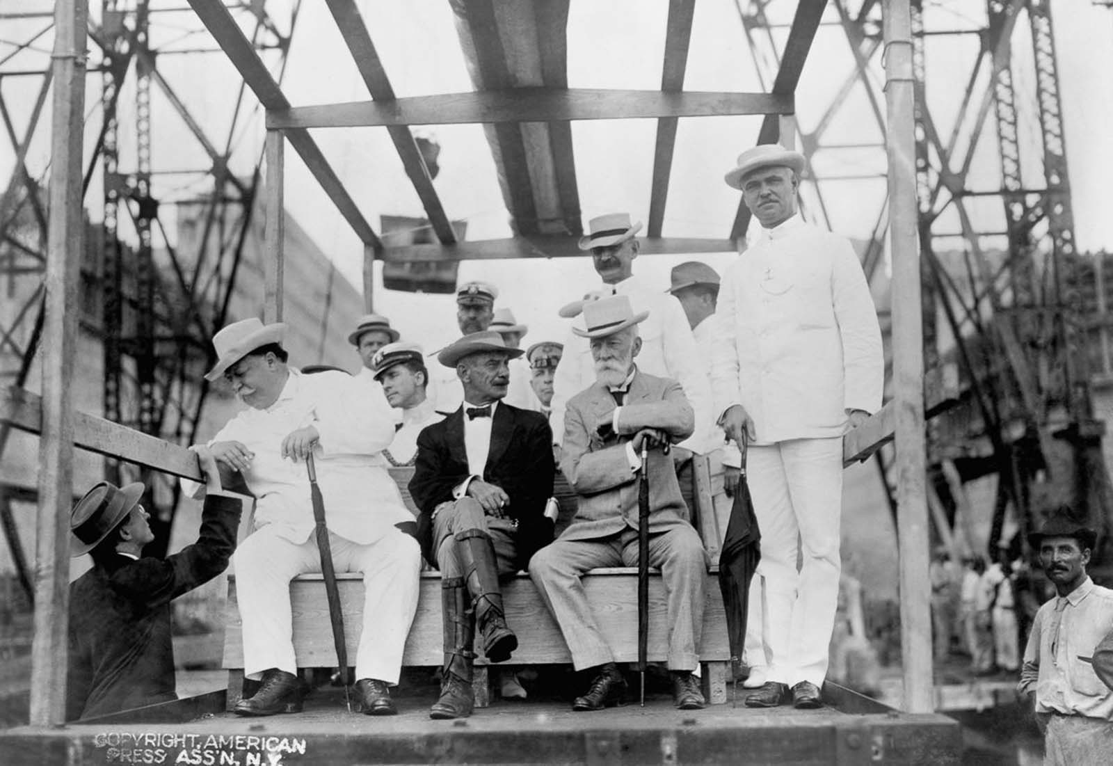 President William Howard Taft (left) visits the Gatun Locks with Supreme Court Justice Oliver Wendell Holmes (seated right) and Chief Engineer Colonel George Goethals (standing right). 1910.