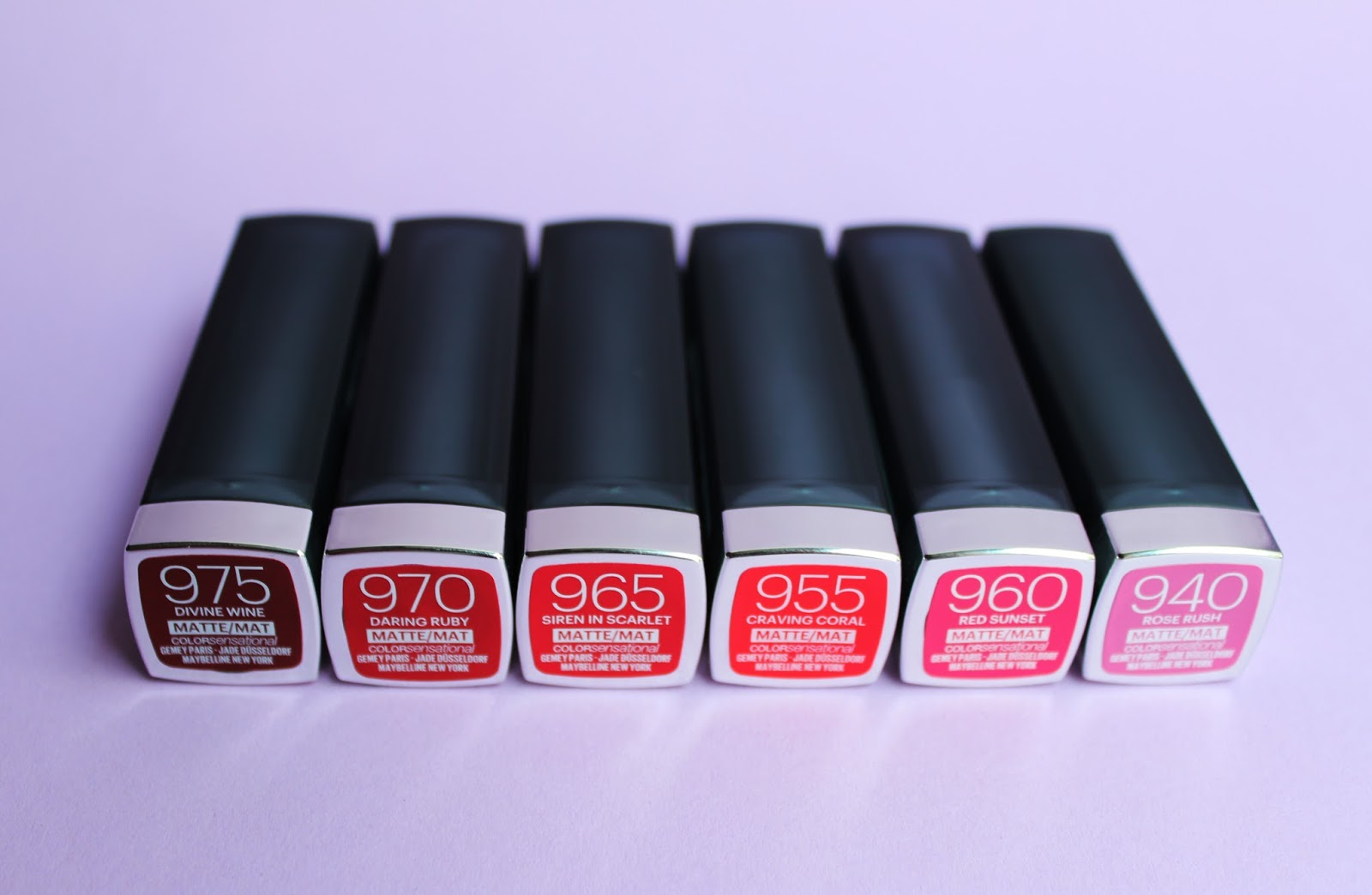 #975 Divine Wine, #970 Daring Ruby, #965 Siren in Scarlet, #955 Craving Coral, #960 Red Sunset, #940 Rose Rush.