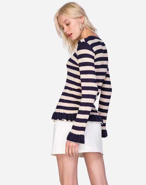 Suéter feito em tricô fino com ponto canelado de alta elasticidade