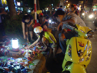 Street stall with housings for mobile in Vietnam