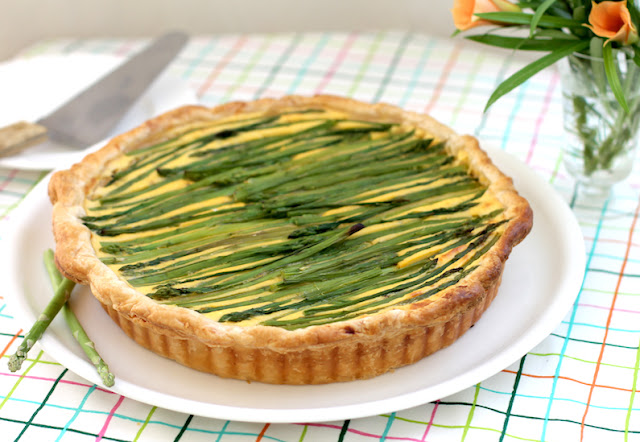 Food Lust People Love: This cheesy asparagus potato tart takes three of my favorite things – crisp puff pastry, cheesy mashed potatoes made with creamy yogurt, and fresh asparagus – and turns them into so much more than the sum of three tasty parts.